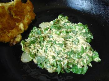 Pomtajer latkes in the pan