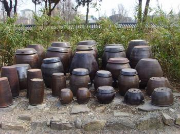 Kimchi pots  aka onggi displayed as a choir, from SSL20015's photostream on Flickr, Debra Solomon, culiblog.org