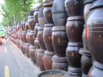 Kimchi pots stored along the side of a busy road, from Jwh8a's photostream on Flickr, Debra Solomon, culiblog.org