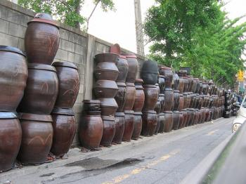 Kimchi pots stored along the side of a busy road, from AtDawnWeRide's photostream on Flickr, Debra Solomon, culiblog.org